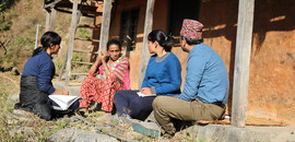 A group of people in Nepal sat down having a discussion